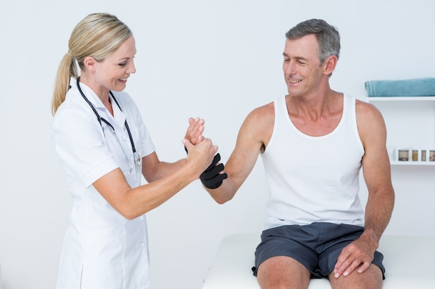 Doctor examining a man wrist