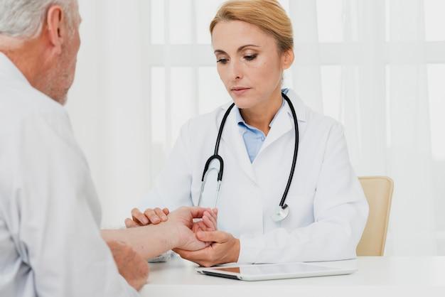 Doctor examining patient hand