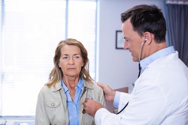 Doctor examining a senior woman