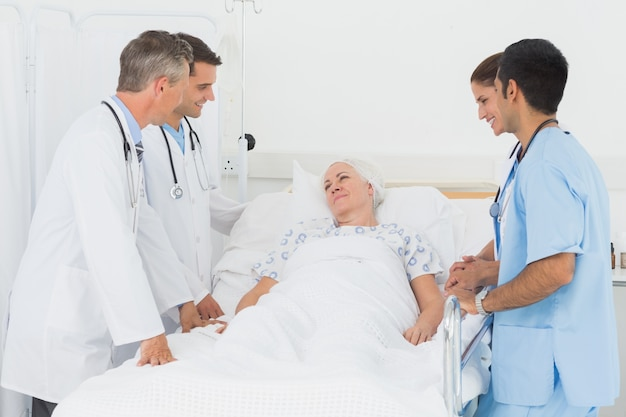 Doctor explaining report to female patient
