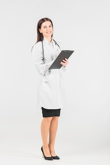 Doctor female smiling and holding clipboard