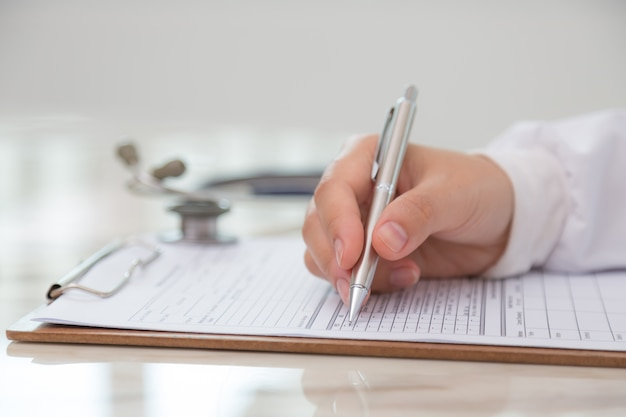 Doctor filling out a medical form
