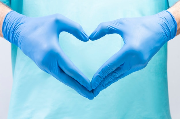 The doctor folded his hands in the shape of a heart.