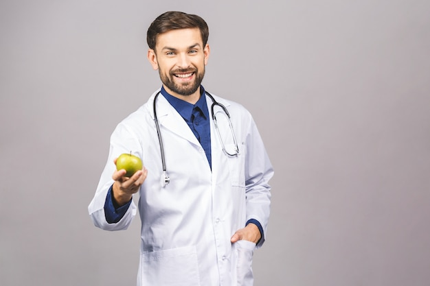 Doctor giving apple concept for healthy eating and lifestyle or good diet