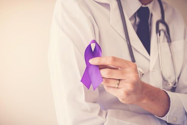 Doctor hands holding purple ribbons, alzheimer disease, epilepsy awareness