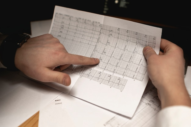 Doctor hold analysis results and learn it after the examination