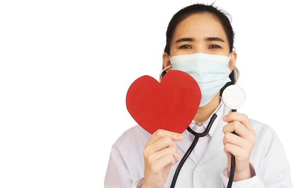 Doctor hold stethoscope check red heart , world heart day