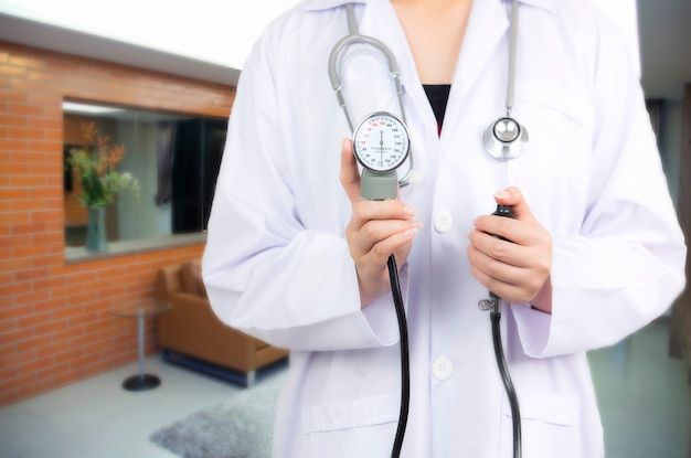Doctor holding  on blurred patient in emergency room