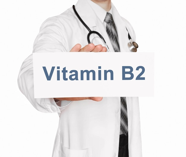Doctor holding a card with vitamin b2, medical concept