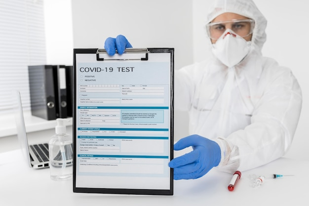 Doctor holding covid test form