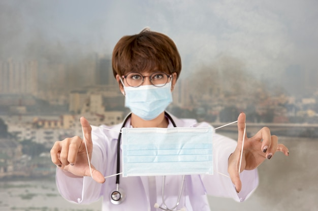 Doctor holding the mask for protect the smoke and pollution. bangkok thailand
