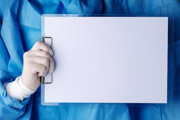 Doctor holding a paper clipboard
