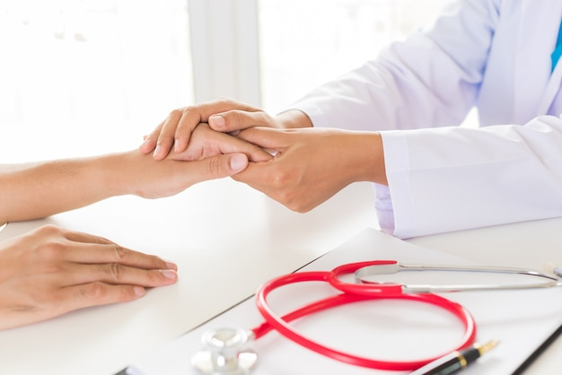 Doctor holding patient's hand. medicine and health care concept