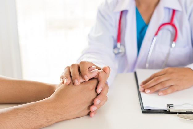 Doctor holding patient's hand. medicine and health care concept.