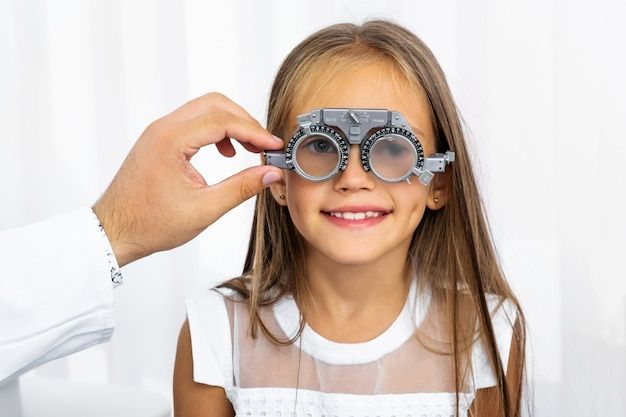 Doctor holding special eye equipment