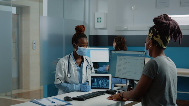 Doctor holding tablet with human body analysis for checkup visit