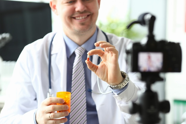 Doctor holding tablets