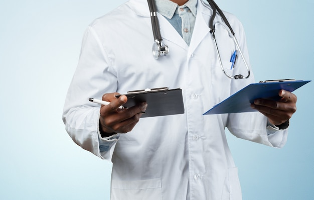 Doctor holding two folders