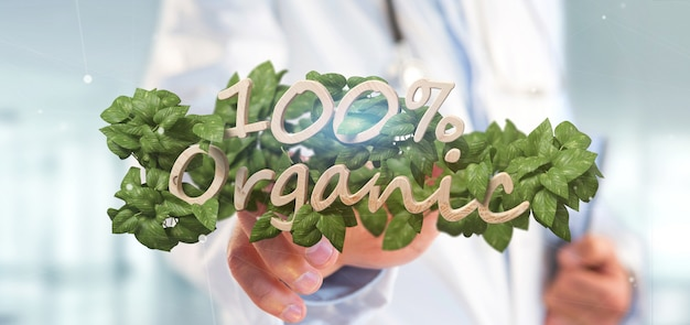 Doctor holding a wooden logo 100 % organic with leaves around