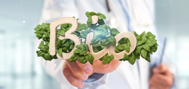 Doctor holding wooden logo bio with leaves around 3d rendering