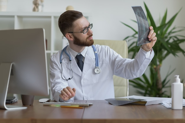 Doctor holding xray