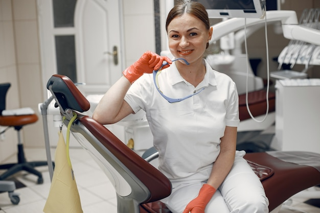 Doctor holds the glasses. woman looking at the camera.dentist is waiting for the patient