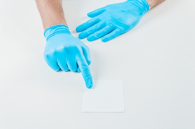 Doctor holds out a white sheet of paper. medical concept.