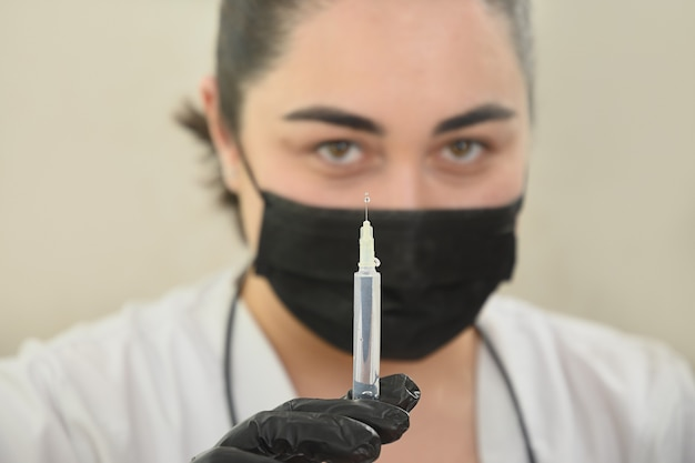 Doctor holds and prepares a syringe for beauty injection caucasian woman