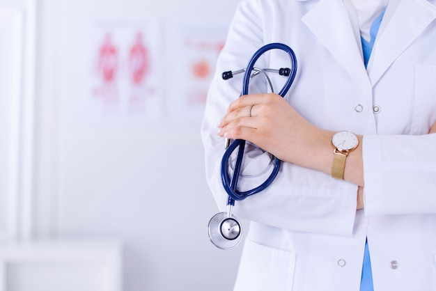 Doctor holds stethoscope in office in the hospital