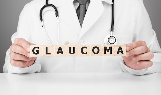 Doctor holds wooden cubes in his hands with text glaucoma