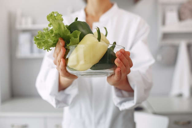 Doctor in a kitchen with vegetables