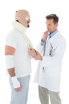 Doctor looking at patient tied up in bandage