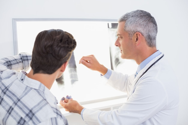 Doctor looking x rays with his patient