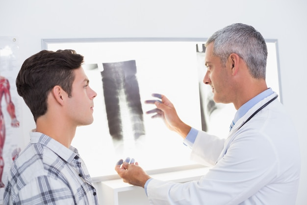 Doctor looking at x rays with his patient