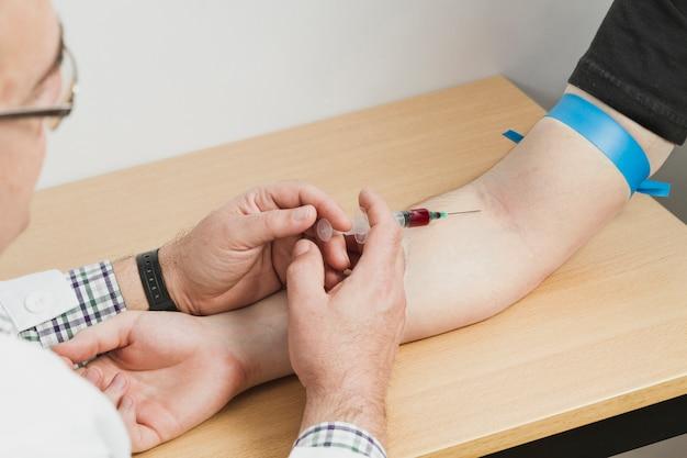 Doctor making blood test