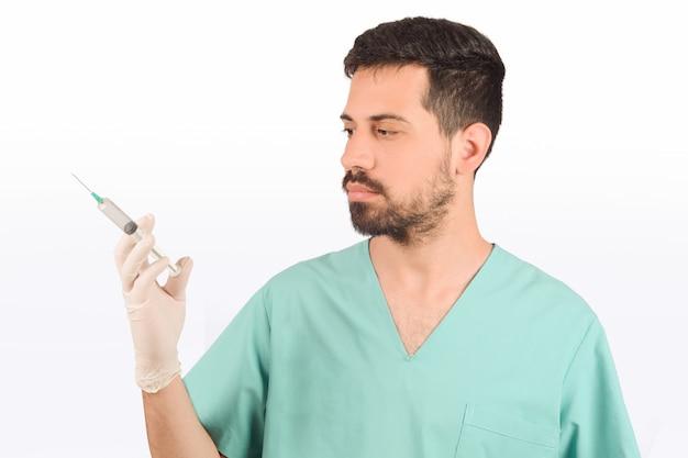 Doctor male holding syringe
