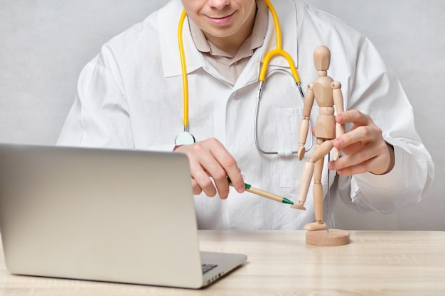 Doctor male teacher gives an online lecture.