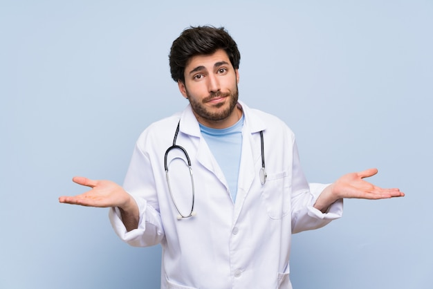 Doctor man having doubts with confuse face expression