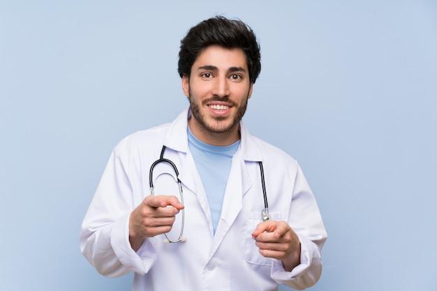 Doctor man points finger at you