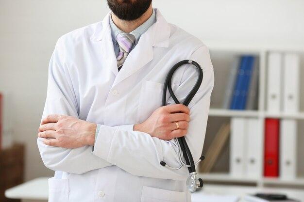 Doctor man portrait in an office
