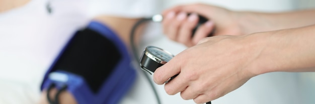 Doctor measures patients blood pressure blood pressure norms by age concept