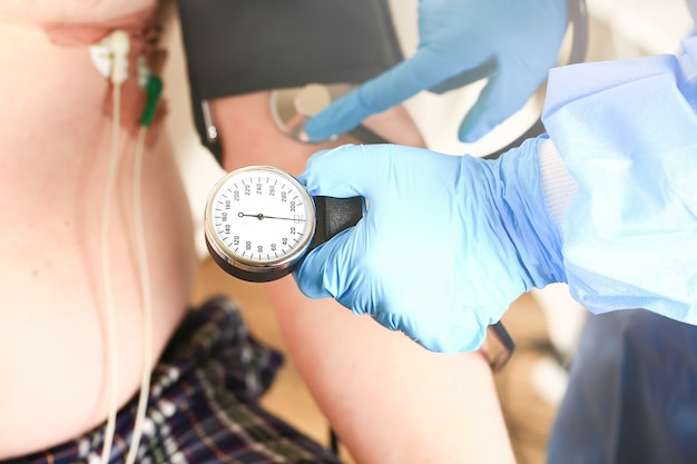Doctor measures the pressure to the patient medical concept selective focus