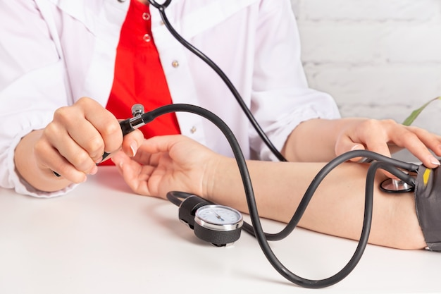 Doctor measuring a patients blood pressure