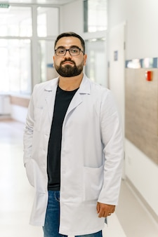 Doctor in medical office. medical worker standing in corridor. medical concept.