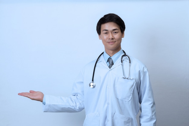 Doctor, medical professional holding something in empty hand