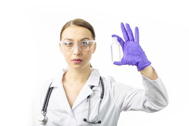 Doctor in medical uniform holding sanitizer dispenser to prevent spread virus