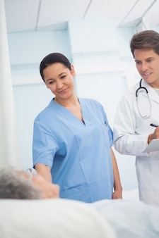 Doctor and nurse looking at a patient