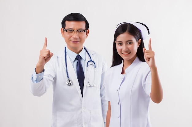 Doctor and nurse, medical team giving number 1 finger gesture