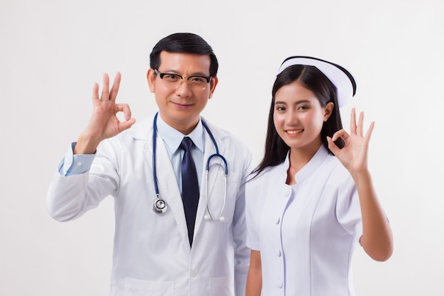 Doctor and nurse, medical team giving ok hand sign