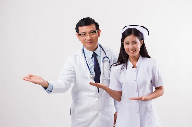 Doctor and nurse medical team pointing